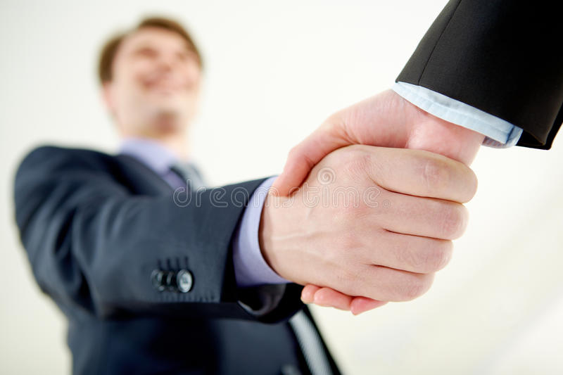 Handshaking of partners. Image of handshaking of business partners on signing agreement royalty free stock photo