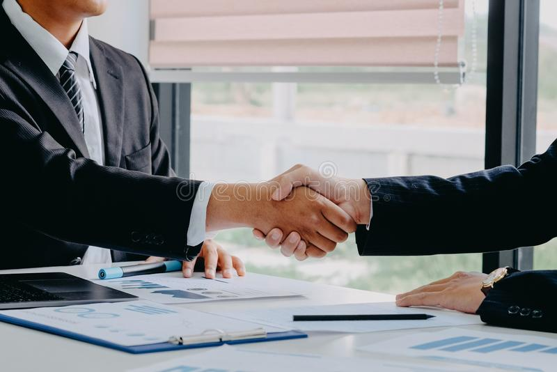 Handshaking. Two businessman shaking hands during a success meeting stock image