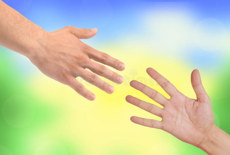 Handshakings over nature background. Conceptual photo of teamwork royalty free stock photo