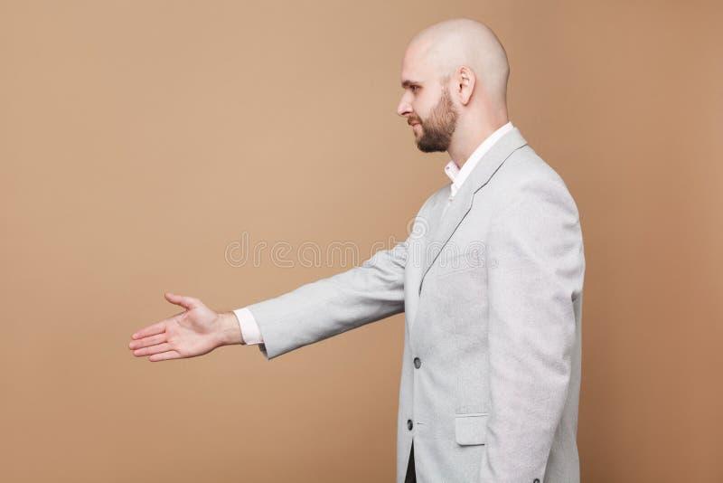 Handskaka och hälsning Stående för profilsidosikt av mitt ag royaltyfria bilder