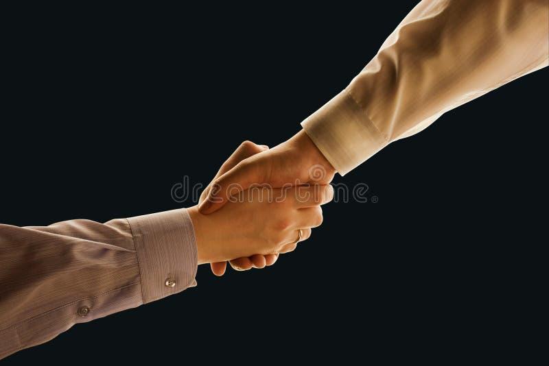 handskakning arkivbilder