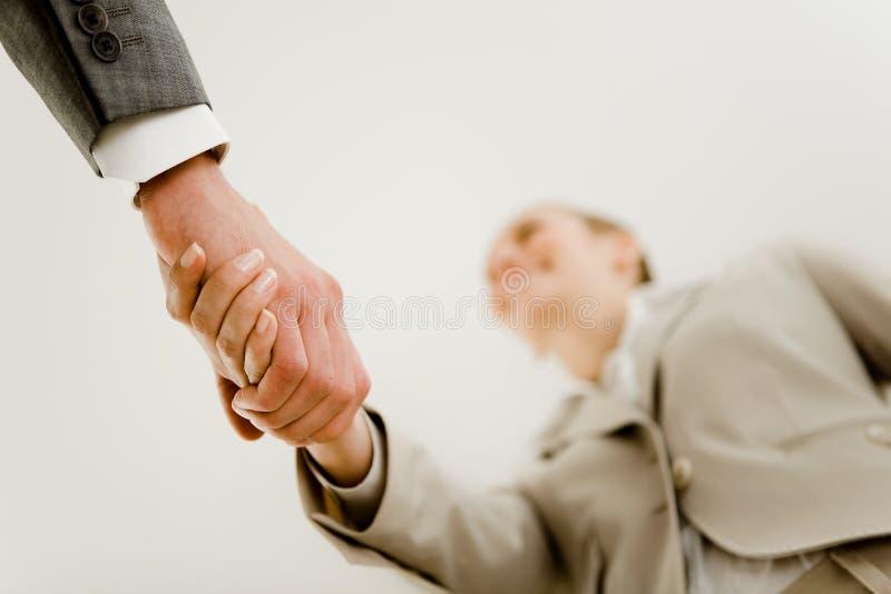 handskakningdeltagare arkivbilder