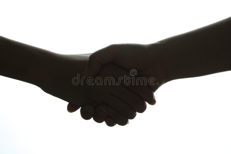 Handskakningkontur arkivfoto