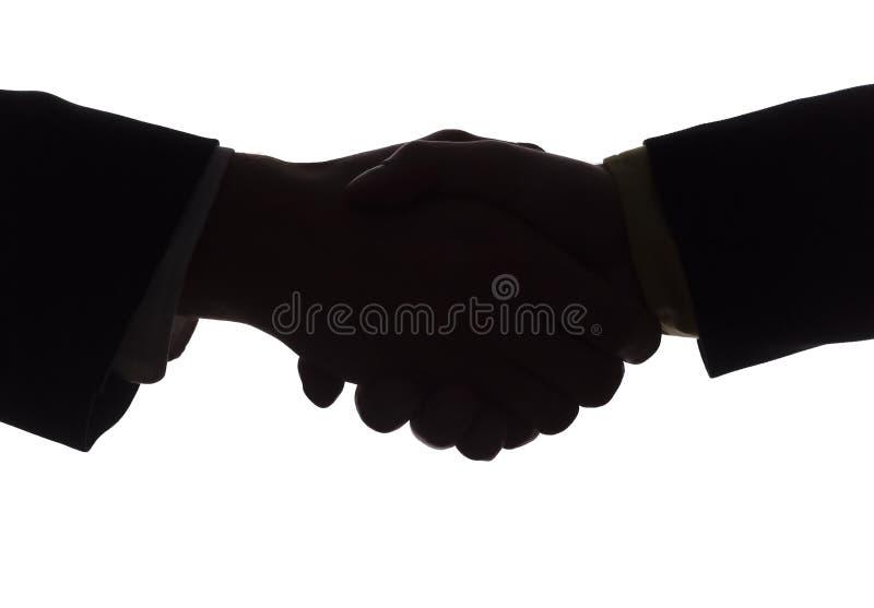 handskakningsilhouette arkivfoto