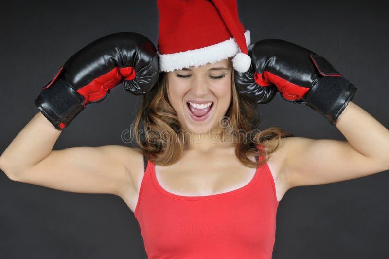 Handskar för boxning för Santa flicka slitage royaltyfri bild