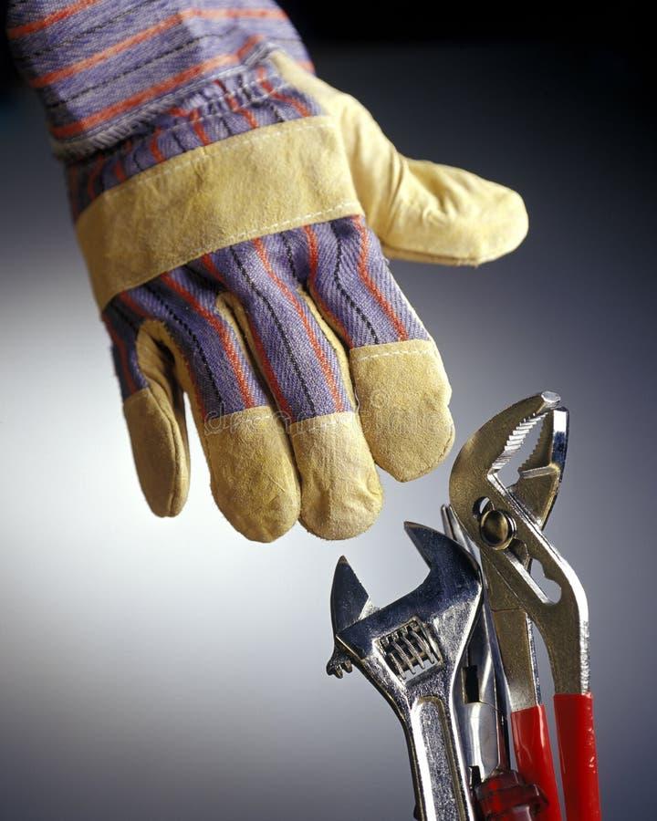 Handske med hjälpmedel royaltyfria bilder