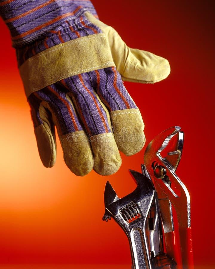 Handske med hjälpmedel arkivbild