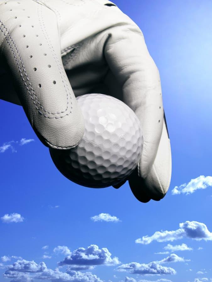 handskegolfballhand arkivfoton