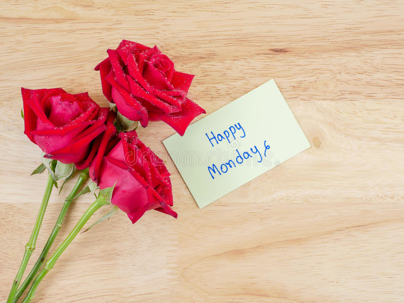 Handskrift lyckliga måndag på brunt etikettpapper 2 arkivfoton