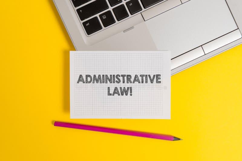 Handskrifttext som skriver administrativ lag Begreppsbetydelsekropp av regelreglementebest?llningar som skapas av en regering arkivfoton