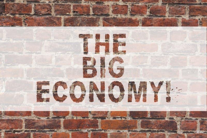 Handskrifttext som skriver den stora ekonomin Tegelsten för utbyte för pengar för handel för marknad för globala finanser för beg arkivfoton