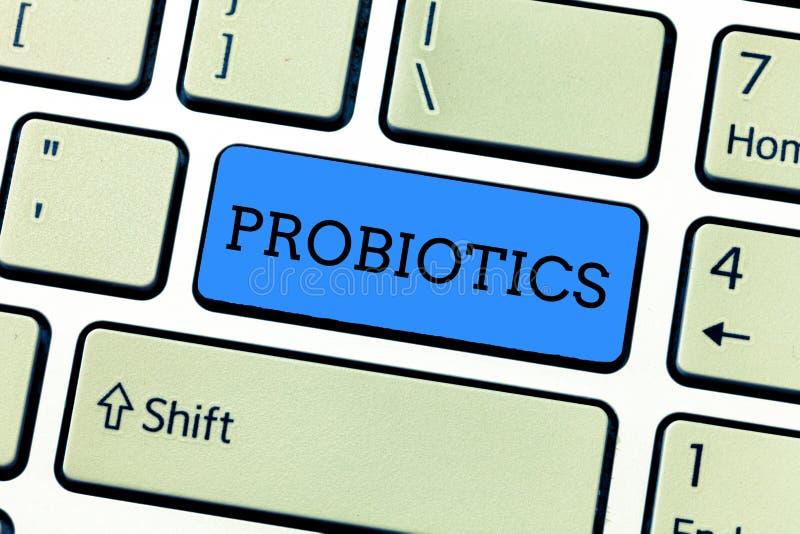 Handskrifttext som skriver Probiotics Mikroorganism för bakterier för begreppsbetydelse som levande vars värd in i kroppen för de arkivfoto