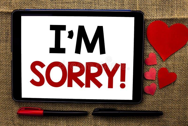 Handskrifttexthandstil ledsen I M Begreppsbetydelsen ber om ursäkt på ångerfullt ursäktande ångerfullt sorgset skriftligt för sam royaltyfri foto