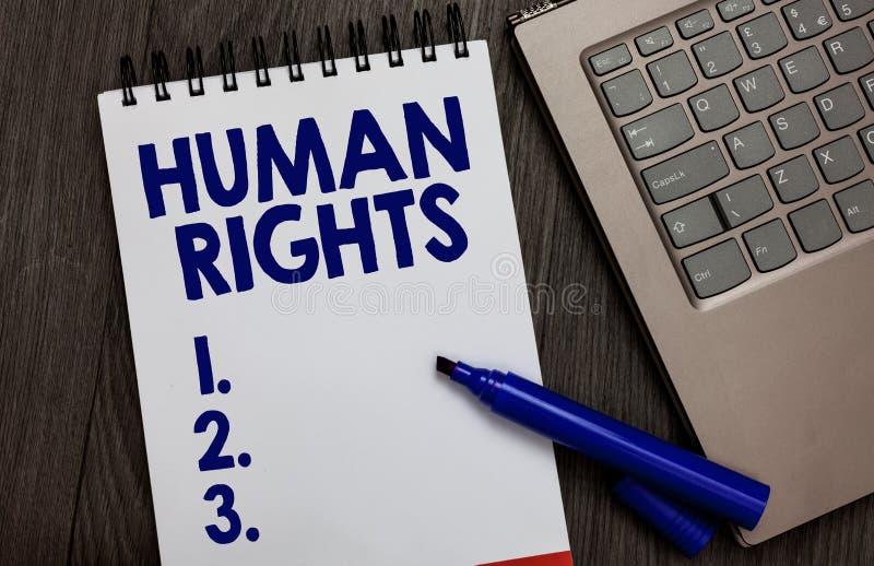 Handskrifttextmänskliga rättigheter Begreppet som betyder normalnormer för moraliska principer av ett folk som enligt lag skyddas royaltyfri foto