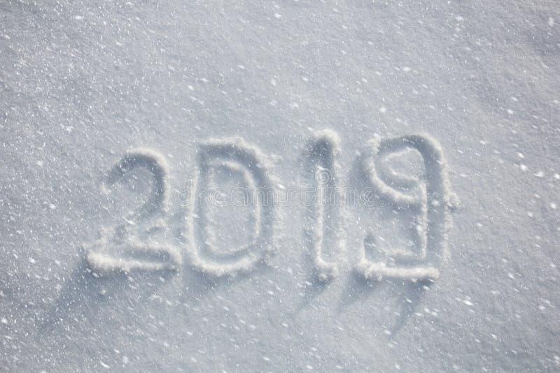 Handskriven 2019 i ny snö arkivfoto