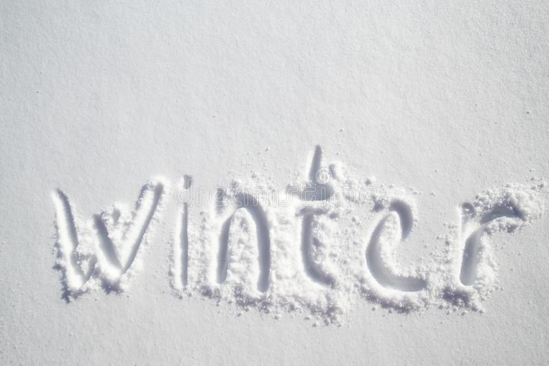 Handskriven inskrift på vit snö - vinter royaltyfria bilder