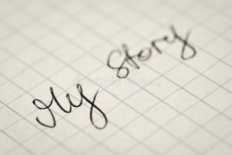 Handskriven text min berättelse på kvadrerad pappers- makro royaltyfri fotografi