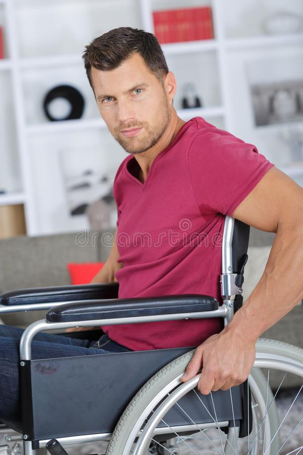 Handsom disabled man on wheelchair. Man royalty free stock photo