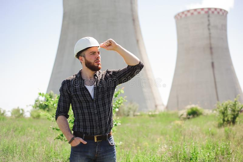 Handsom electrical engineer at an electrical station. Handsom electrical engineer at an electrical station royalty free stock photos