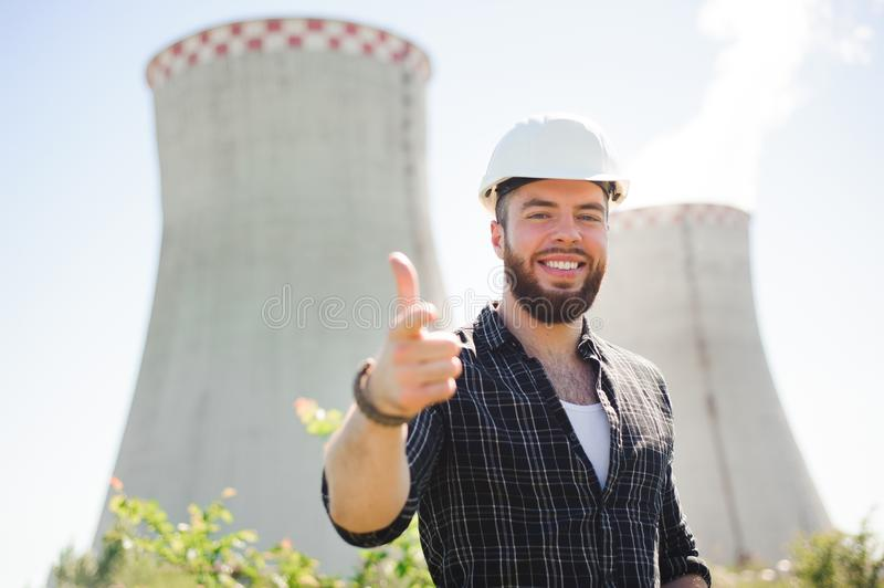 Handsom electrical engineer at an electrical station.  royalty free stock images