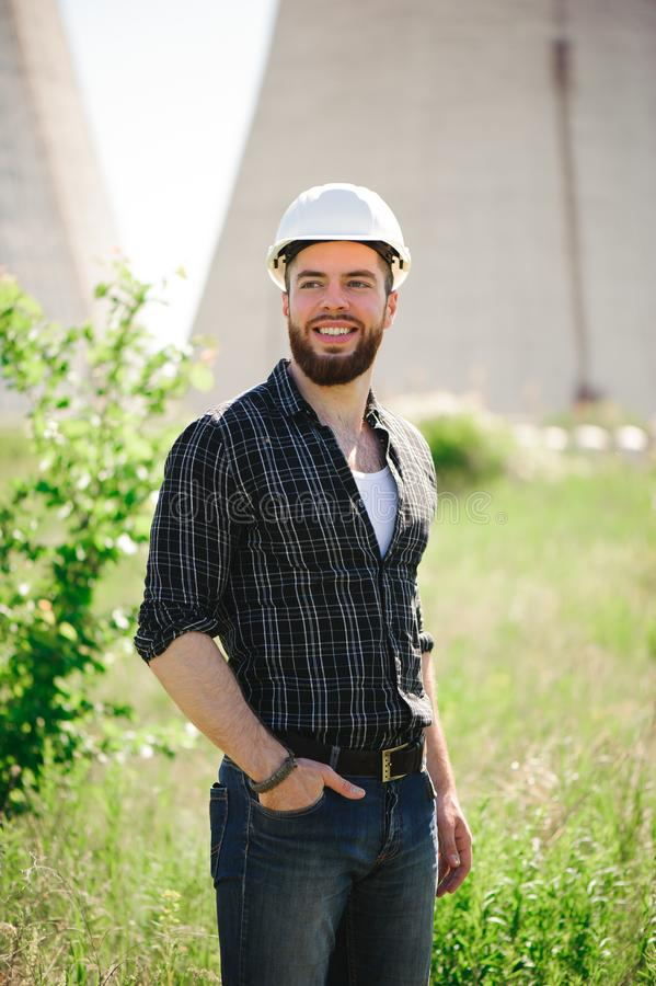 Handsom electrical engineer at an electrical station. Handsom electrical engineer at an electrical station stock images