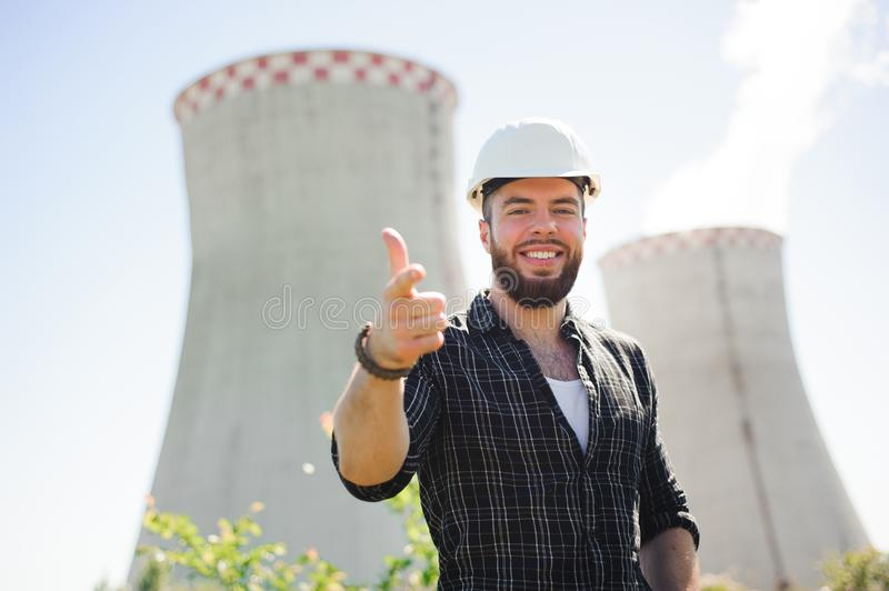 Handsom electrical engineer at an electrical station. Handsom electrical engineer at an electrical station royalty free stock photo