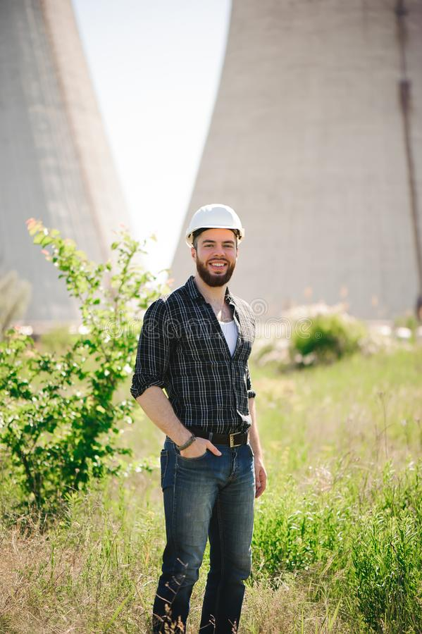 Handsom electrical engineer at an electrical station.  royalty free stock photo