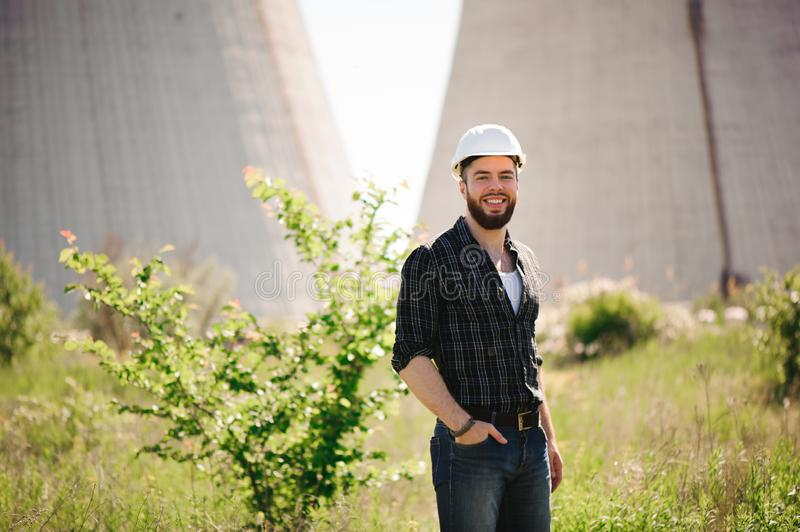 Handsom electrical engineer at an electrical station. Handsom electrical engineer at an electrical station royalty free stock photography