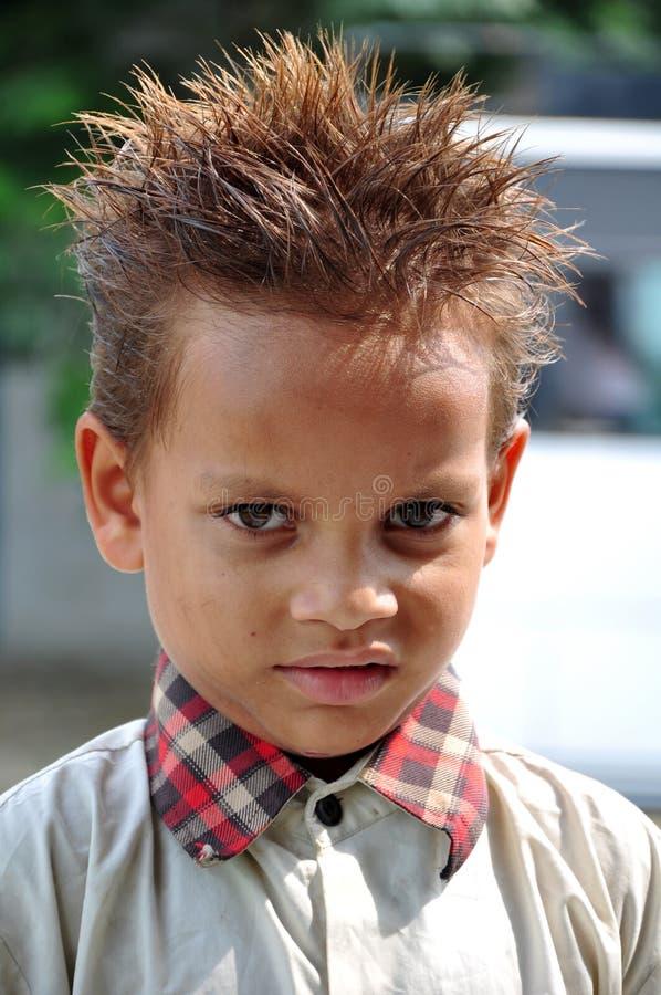 Handsom kid. Beautiful shot of smiling handsom indian kid royalty free stock photos
