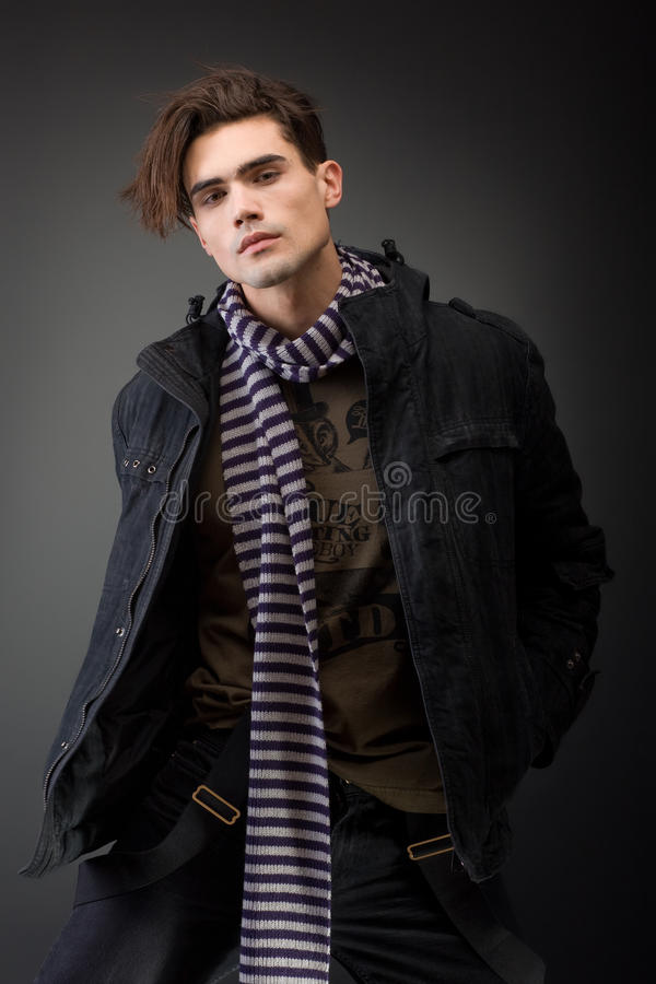 Handsom young male model with serious attitude stock photos