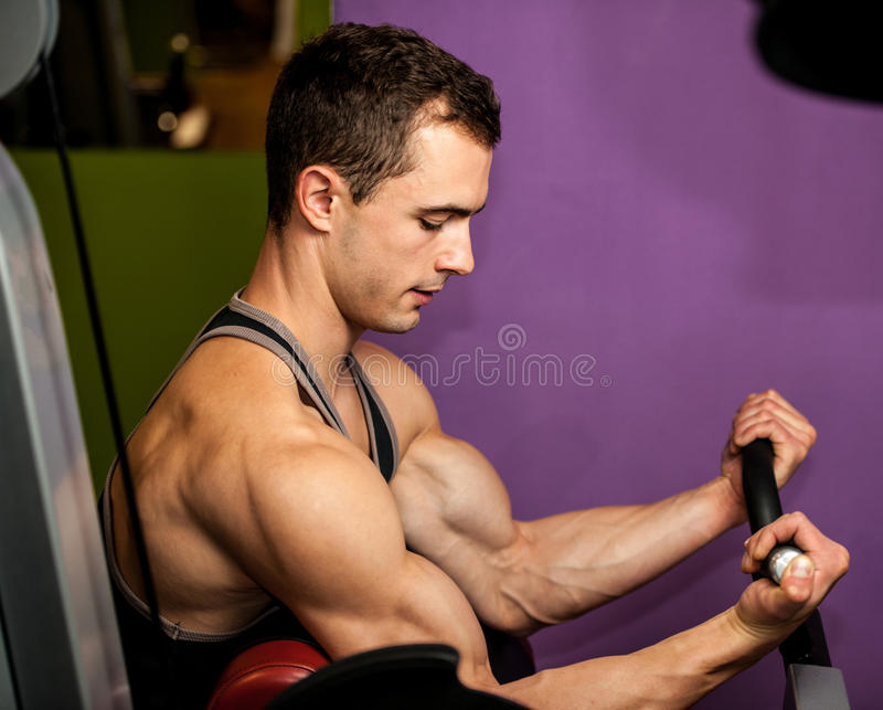 Handsom young man workout in fitness gym. For healthy and muscular body stock photo