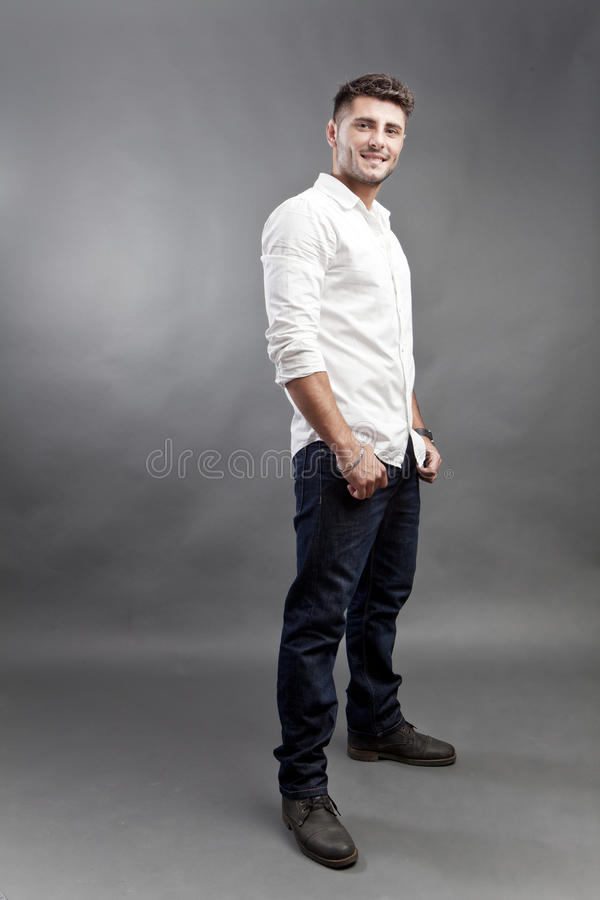 Handsome. Young man on studio background stock images