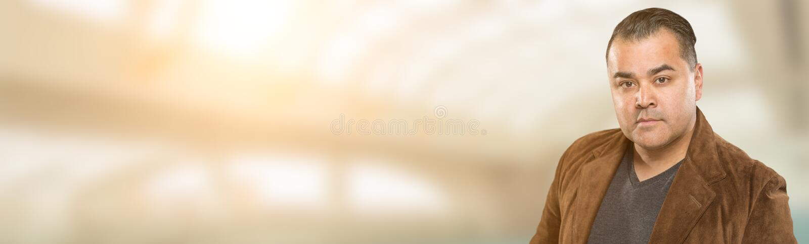 Handsome Adult Hispanic Male Portrait Wide Banner with Room For. Text royalty free stock photography