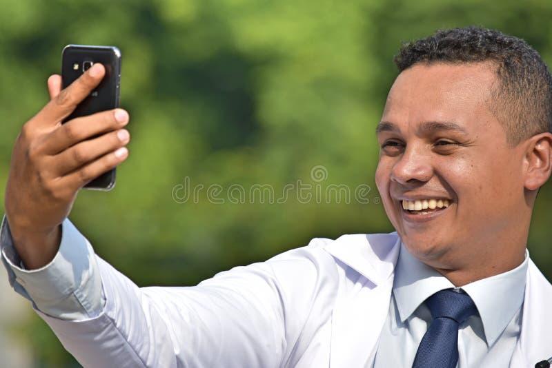 Selfie Of Male Medic Wearing Lab Coat. A handsome adult hispanic man stock image