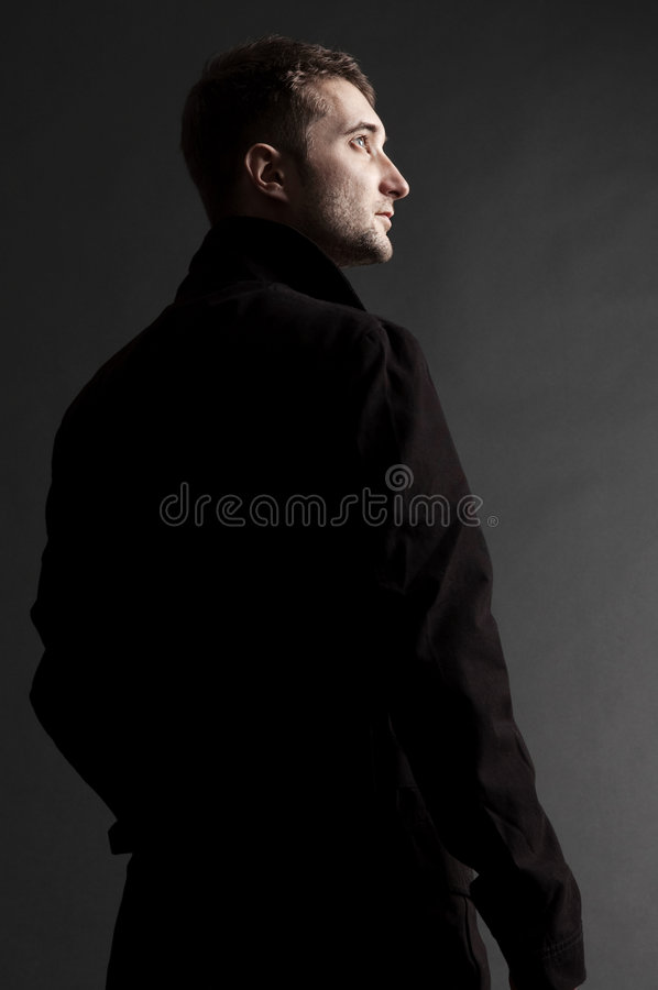 Handsome adult man looking up stock photos