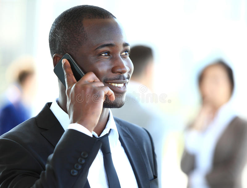Handsome african american businessman talking on mobile phone stock images