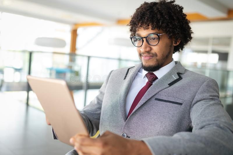 African american businnesman using tablet close up royalty free stock images