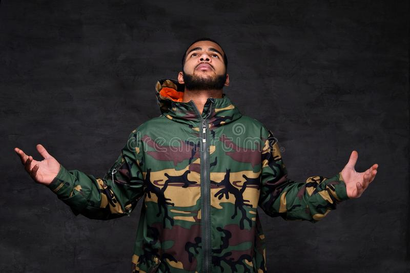 Handsome African-American guy wear military jacket. stock images
