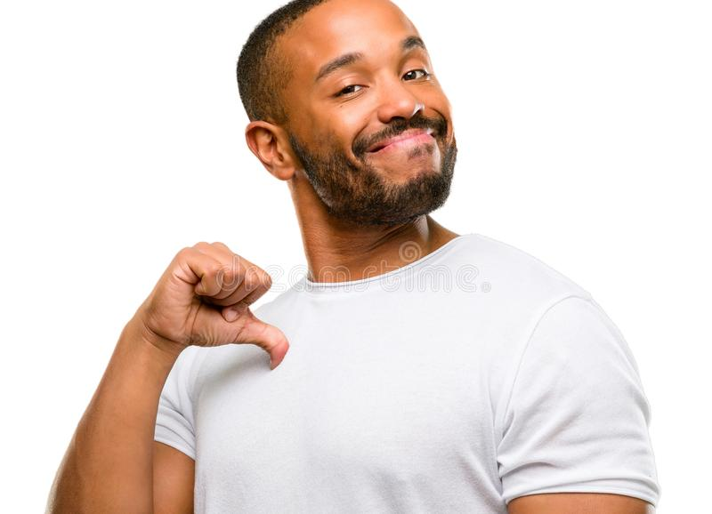 Handsome african american man. African american man with beard proud, excited and arrogant, pointing with victory face isolated over white background stock image