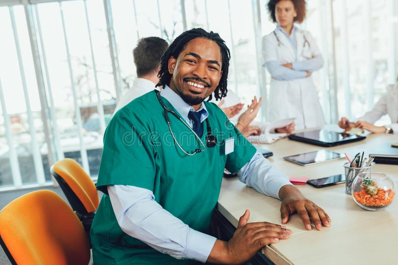 African american medical doctor with colleagues in background royalty free stock photography