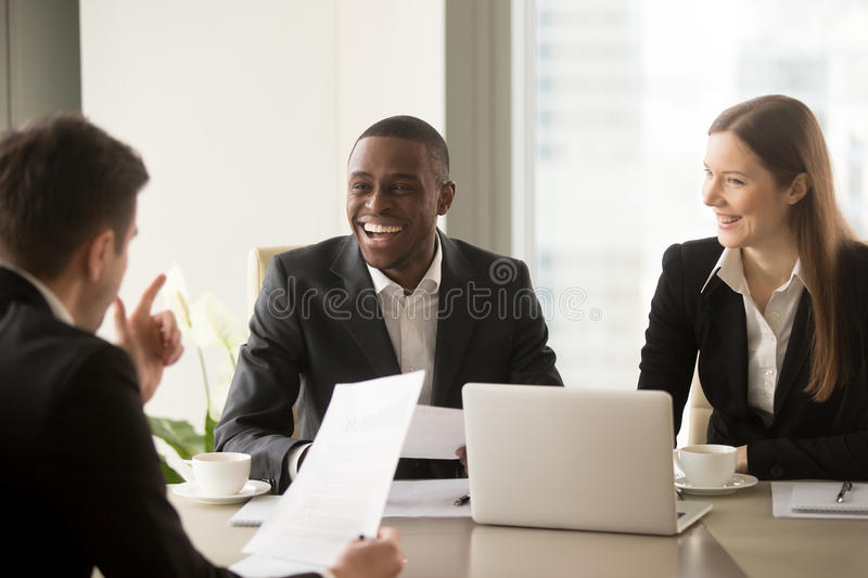 Handsome afro american businessman laughing, having fun on busin royalty free stock photos
