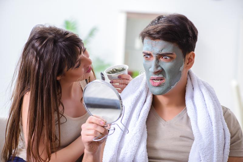 The handsome applying clay mask on face royalty free stock photo