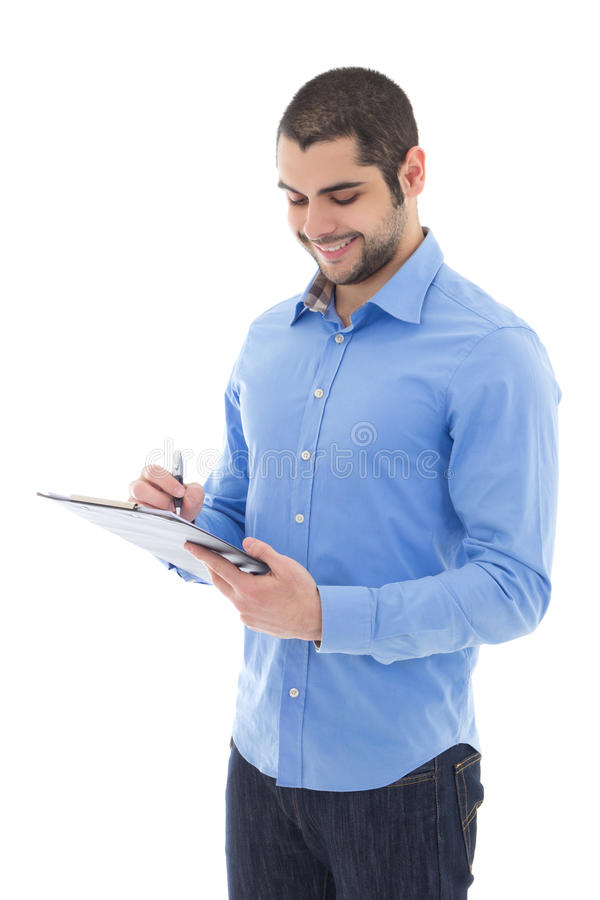 Handsome arabic man writing something on clipboard isolated on w royalty free stock photo