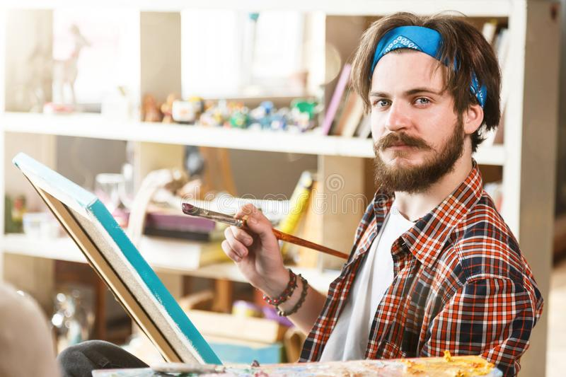 handsome artist with brush and canvas stock image image of