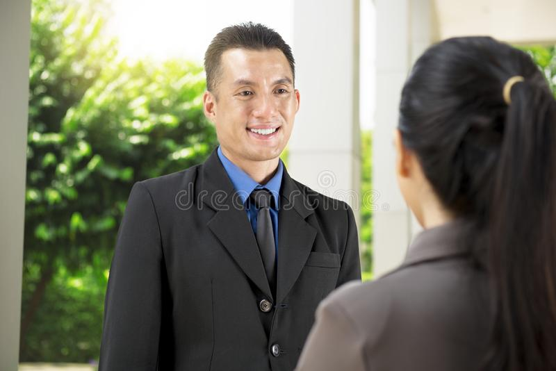 Handsome asian businessman discuss about business plan to his co stock images