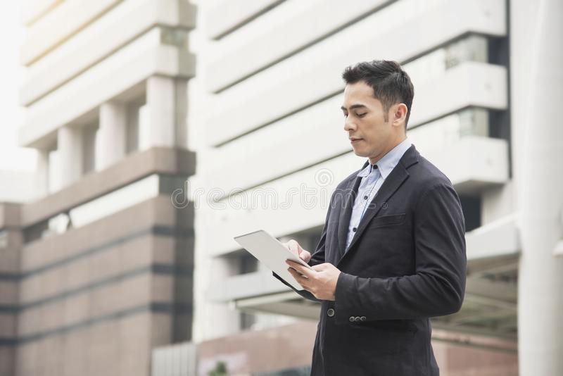 Handsome asian businessman using tablet. concept technology stock photo
