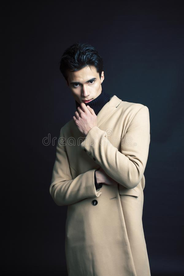 Handsome asian fashion looking man posing in studio on black background, lifestyle modern people concept close up stock photo