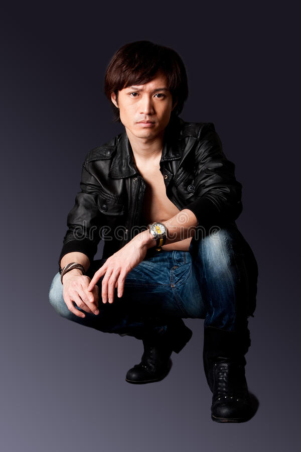 Handsome Asian man with leather jacket royalty free stock photo