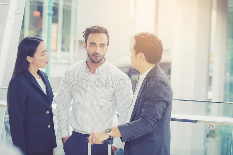 Handsome asian young businessman and businesswoman three people stock images