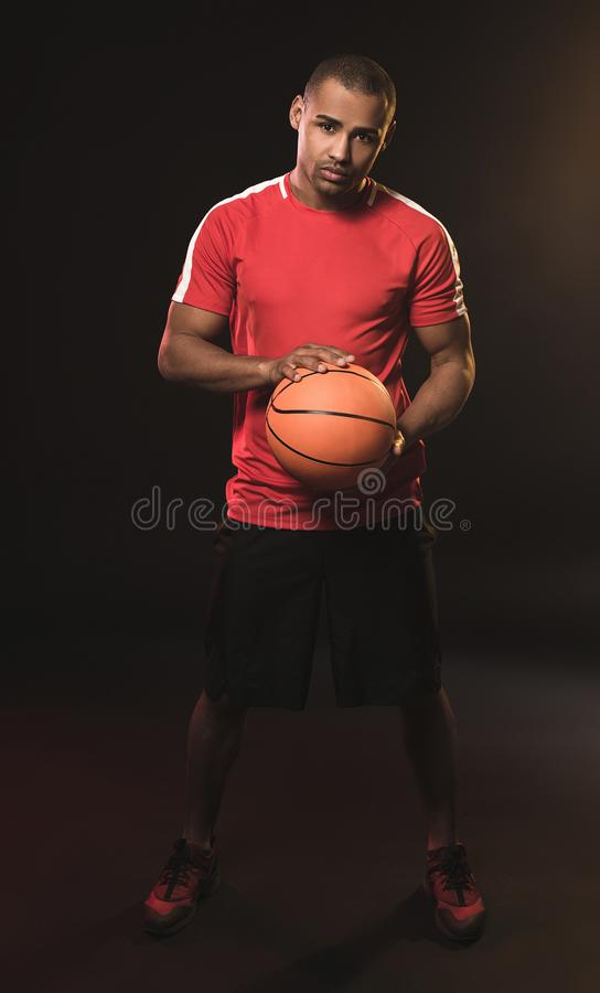 Handsome athletic guy borned for the game royalty free stock photo